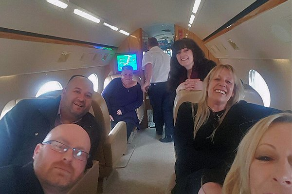 Management Team enjoys a charity private jet flight