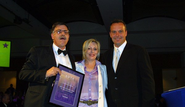 Keran with Ted Konidis and Andrew Daddo receiving industry recognition award